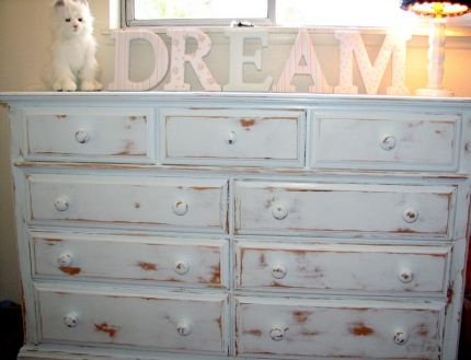 My daughters were in desperate need of a new dresser. I was so excited to find this one yesterday at Goodwill along with the shabby chic collection of Dream Letters. The dresser was just missing a couple knobs which ended up being inside the drawers. It was just a plain old stained knotty pine. I painted it a very faint shade of blue....really more white than blue.... and of course I distressed it.  Best of all,their clothes are all put away now!!!