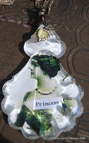 The focal of this necklace is a lady image with the word Princess encased in vintage glass.