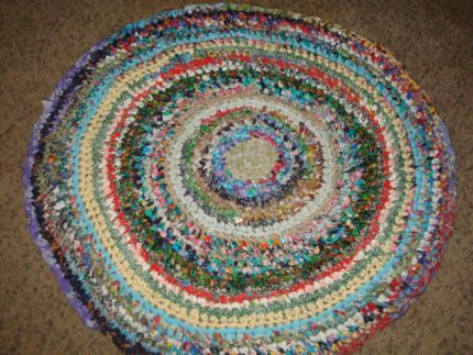 I had tons of fabric scraps left over from quilts, and not wanting to toss them, they had been piling up! So, this is my first attempt at a rag rug. I cut all the scraps into strips and sewed or tied them together and crochet them into a rug. I Cleaned out a ton of space in my sewing room, and my dogs think I made it just for them to nap on! Everyone is happy!