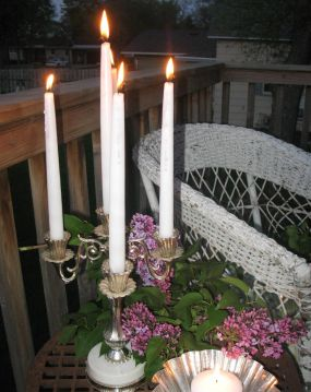 This $4 thrift store candelabra find is a warm welcome for friends on the back patio...
