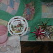 The plate is from Norway which is where my great grandmother was from.  The star type ornaments (which are called sputniks) hung on our family Christmas tree each year as kids.  Picked up one for me and my 3 sisters.  There is also a pink McCoy plantar (which was a steal).