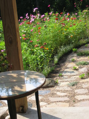 The first path I built this summer.  The plantings are varying rosemary, creeping plants, violets, etc.
