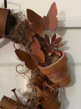 All potted up for a rusty wreath! ---- pieces and parts from Carols wreath.