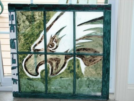 This is the finished window with a forest teal green acrylic wash.  The eagle head was painted with glass paints.  The wood frame was coated with 2 coats of polyurethane.  I wanted to crackle finish it but this way was a little brighter.