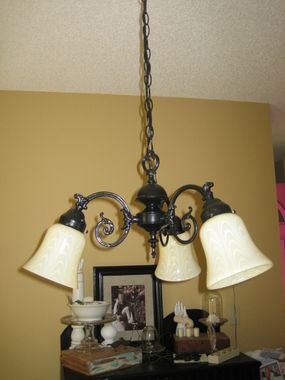 This is how the light fixture turned out with a paint job and new glass globes. Total cost $6.50