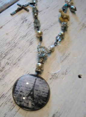 The lower portion of this necklace is a mix of found elements and jewelry treasures combined to make this Paris themed necklace.