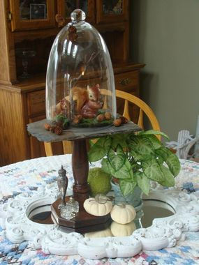 Two vintage squirrels (mom and her little one) looking too cute on my dining room table)...