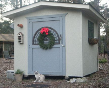 Dressed up the garden shed for the holidays! It is a slow process, but it is coming along nicely. I now have a potting bench, shelves and pegboard in place on the inside. The outside is now painted Chatroom and eventually the door will be painted black. Family was coming for the holidays and we did a quick paint job for now. One day I hope to have siding put on to match my house and there will be LIME GREEN somewhere! I even have windows I found as roadside treats to be put in one day, hopefully. I feel like a little girl with a playhouse.