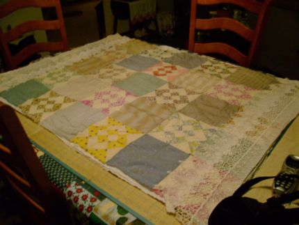 started with a antique hand sewn quilt top