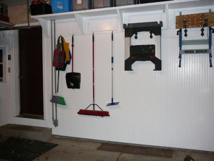 I found misc. hooks and brackets which work out great to hang all the stuff.