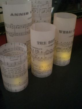 Heres a photo of some candle hurricane shades I recently made for my booth at an art show exhibit.  These have a music theme - made with vintage sheet music from flea markets-