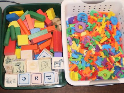I was inspired by my mound of blocks I already had so I found more bags of blocks and magnetic letters for less than $2 a bag.  I couldnt get them all in the picture but trust me, theres more!