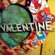 Vintage Valentine cards are randomly placed to create a mosaic of sentiment.