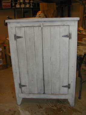 Primitive cupboard built around an old shed door