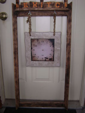 This was an old mirror frame that JB sanded down and burned the grain for old look.  When finished it can lean against the wall or be hung up