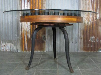 "Right out of the industrial revolution, the heavy iron table base was once a machine base at the CRANE MFG. BUILDERS LAKEPORT, NH. The table is topped with a 54"" piece of 3/8"" pencil polished glass and would make a beautiful dining or small conference table."