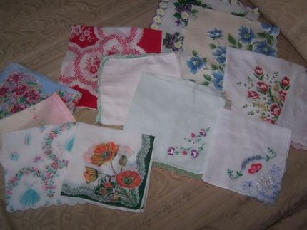 vintage hankies. For now, I am keeping them as they are and just displaying them with my other vintage linens. Maybe someday I will incorproate all of them into a project.
