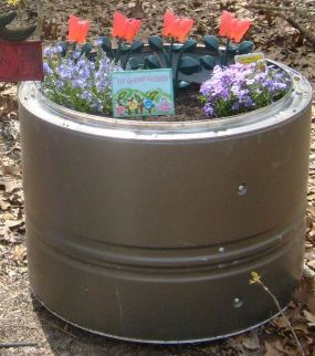 One of my 3 yr olds Butterfly Gardens. We used old dryer drums that were being scrapped. They hold a lot of clothes & a lot of dirt!