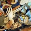 wooden spool of thread, mini salt shakers, mahjong tiles, sparkly ceramic orbs, ceramic covered trinket holder, brass No.5, wire basket (underneath it all), weathered 3 part picture frame, shoe stretcher, sea shells, cut glass bottle stopper, flower medallion and...