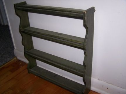 this is a little green shelf. I think it might be a spice rack?