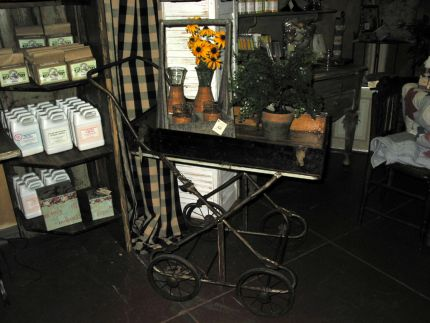 This little cart made from a recycled baby buggy and the top of an old trunk can be wheeled anywhere but would look great on a porch as a tea cart.