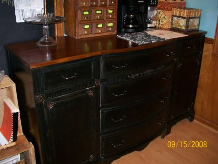 This dresser was dull and drab but had a terrific mahogany top so, i refinished the top and painted the rest black.