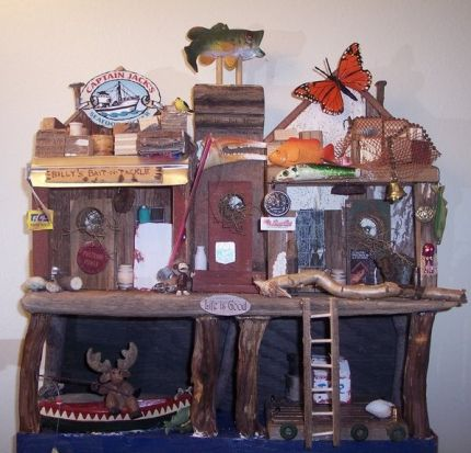 This is my personal birdhouse.  My daughter and I went to Alaska to visit friend.  We had a blast.  I enjoyed collecting junk as much as fishing.  A board in the water, bottle caps, signs, etc collected and compiled to a memory.  I was deamed crazy by my friend. LOL.  Getting excited over a stick he says.....