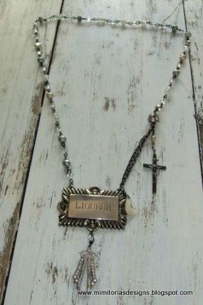 Vintage English Liquer tag with grey, white and crystal wire wrapped beads and semi precious gemstones.  Vintage crucifix and mother of pearl teardrop.