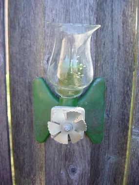I repurposed the sprinkler into a candle sconce on the fence.