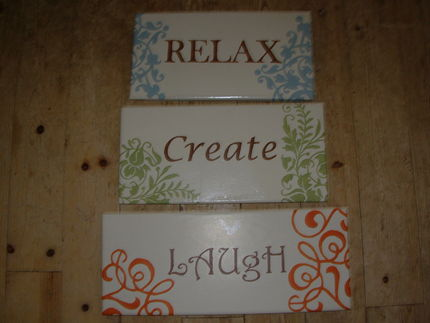 I sanded the wood, painted a base coat, and then use clip art & graphite paper to transpher my designs.  Next, I painted my signs with acrylic paint.  I then sealed them with a clear spray.