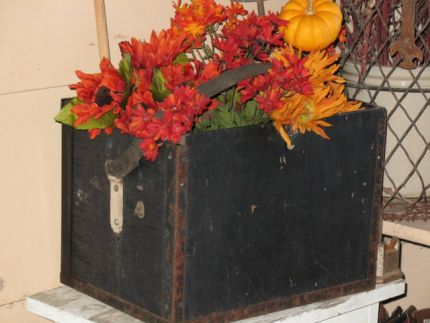 A real fun box that almost made it to the next sale. It has a leather strap on it and rusty metal on the edges. Just right for my Fall bouquet.