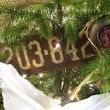 Three vintage licence plates from Anything Goes Here Etsy offers the tree its main theme. Pretty. Junkin. Cool. :)