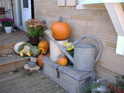 A watering can, trunk, crock, and a few pumpkins . . .