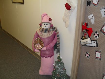This little missy greets you with some yummy peppermints at my office door.  She is stuffed with wal-mart sacks and models thrift store sweaters and accessories.