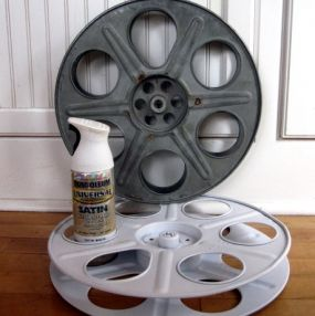 You start a vintage movie reel. Make sure that you have removed any remaining film from the reel before getting started. I decided to give this reel a cottage appeal so I chose a satin white spray paint. If you want you could go to a high gloss. Im a big fan of Rustoleum products and this particular type of spray can is my favorite in their line. Less mess!