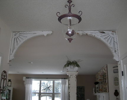 Corbels were added to my entryway to take a plain, blah and average entryway into a unique, one of a kind, interesting entryway.  The square pillar in the background is free standing and can be topped with different items.  Currently it is topped with a capital from a pillar and can be filled with different elements according to the season.