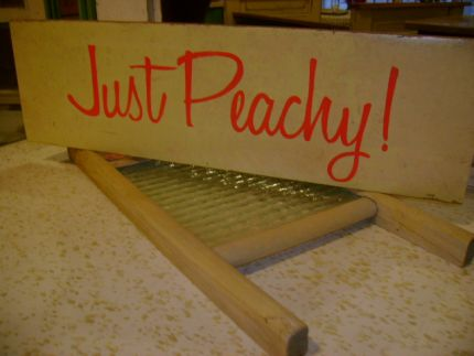 Hand painted sign made from a bed rail