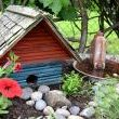 I call this The Bird Spa. A birdhouse and cow feeder aka hottub created a cute little vignette inside...