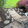 Desire a little pathway? How about a few old pallet boards? Its a super easy keeper. Too many weeds? Lift the board up, pull and lay it back down. Easy! Now just imagine it finished with beautiful rock garden plants sprawling all over those rocks. Because I sure am.