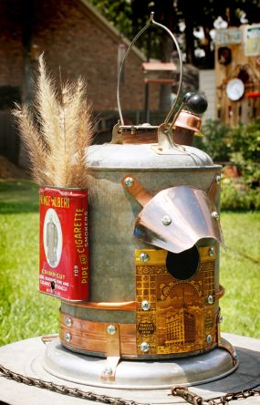 Galvanized Gas Can with Attached Prince Albert Tin and Other Parts Make Upcycled Bird House.