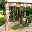 A photo showing the left side of the display and some of the jewelry merchandised on it. I can fit 9 necklaces from it with the way we designed it.