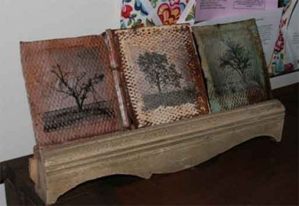 Trees displayed on a piece of what was once an old cradenza.  Ive been lugging these furniture scraps around for almost a decade- glad to finally put them to use.