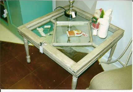 Table made from 2 windows hinged together.  I was lucky enough to find the diamond window on trash day!  I put mirror in the center only.