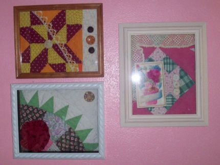 cut up old quilts, added embellishments, and framed.