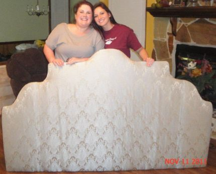 Christina and I with the finished headboard!  It was midnight and, after working at it since we left work at 5:00, we were looking a little rough.  ;-)