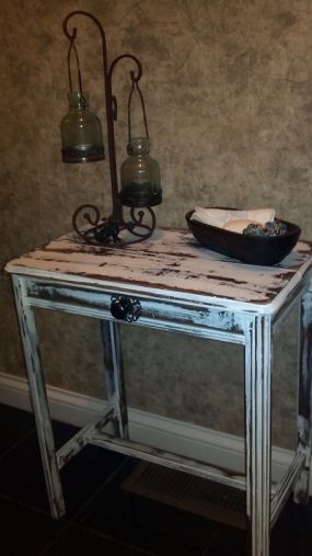 I purchased this table at my favorite junk store for $3.  Added a some paint and hardware and it fits perfectly in my little bathroom.