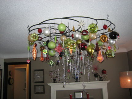 Julie states that her house is on the smallish size, so to take up space with a Christmas tree just doesnt make sense.  Her solution, a layered chandelier style bling from the ceiling to represent the holidays.