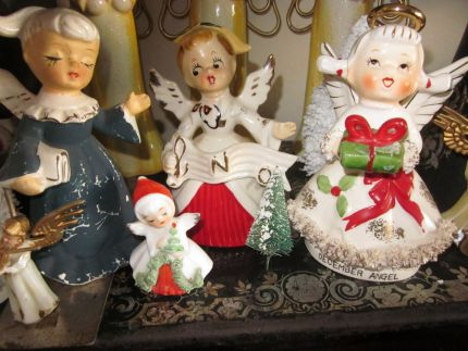 I love the old porcelain angel decorations. The blue one and the tiny one were found for free at The Crumpton auction a few yrs ago, and the others were thrift store finds.