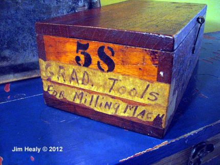 An antique parts box is enriched with stencils.