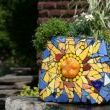 http://www.junkmarketstyle.com/item/37227/toilet-tank-turned-mosaic-planter From Michael...
